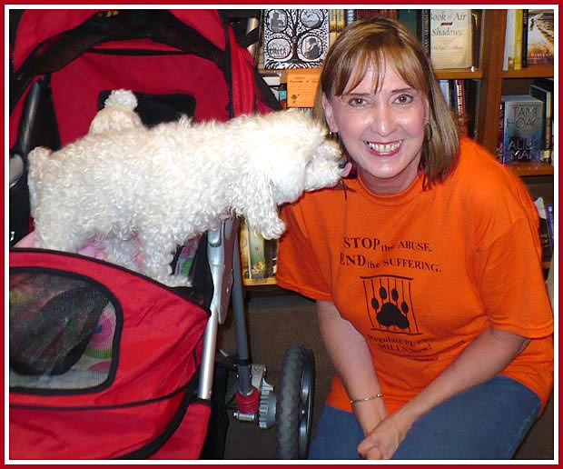 Baby, Puppy Mill Survivor, greets Debbie, NoWisconsinPuppyMills supporter, at a booksigning in Milwaukee, WI on 2 July 2008